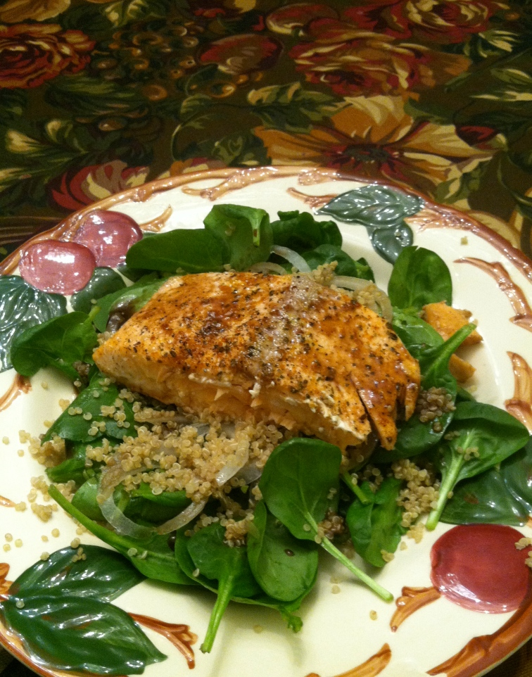 Roasted Salmon with Maple Vinaigrette on bed of fresh spinach, Vidalia onion, and quinoa.